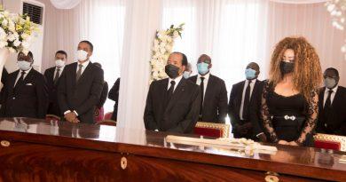 Biya wears facemask